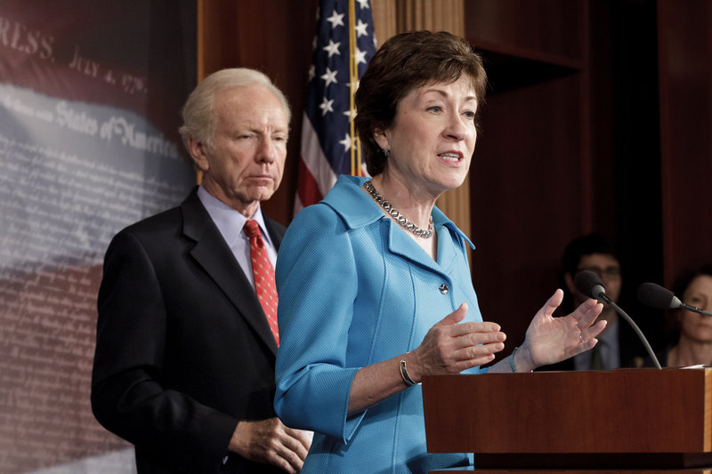 Sen. Susan Collins, R-Maine, the ranking member of the Senate Homeland Security Committee, right, accompanied by the committee's Chairman Sen. Joseph Lieberman, I-Conn., gestures during a news conference on Capitol Hill in Washington, Tuesday, July 24, 2012, to announce that the Senate will take up legislation later this week to protect critical U.S. industries and other corporate networks from cyberattacks and electronic espionage. (AP Photo/J. Scott Applewhite)