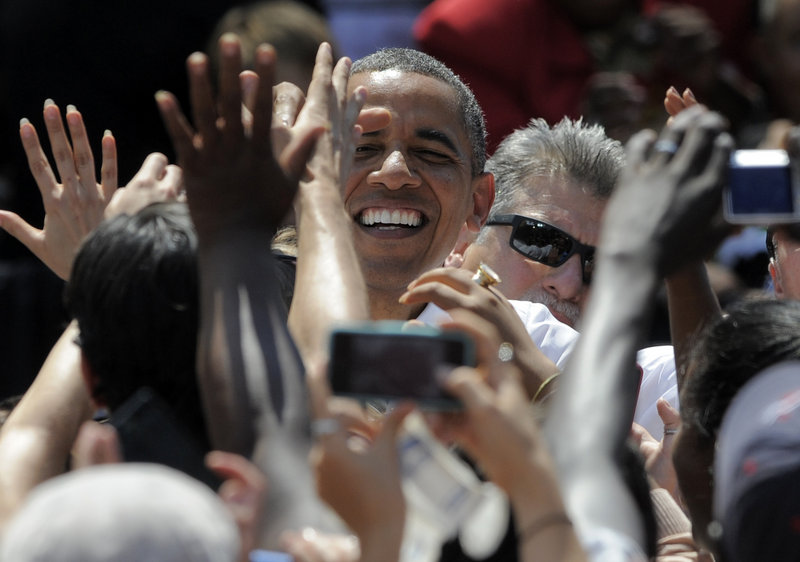 President Obama greets supporters during a rally Thursday at Colorado College in Colorado Springs, Colo.