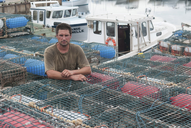 "Jean-Pierre Cormier, the spokesman for a group of lobstermen on Aboiteau Wharf in Cap-Pele, New Brunswick, says, ""We can't fish for $2.50 a pound. How do you make a living on that?"""