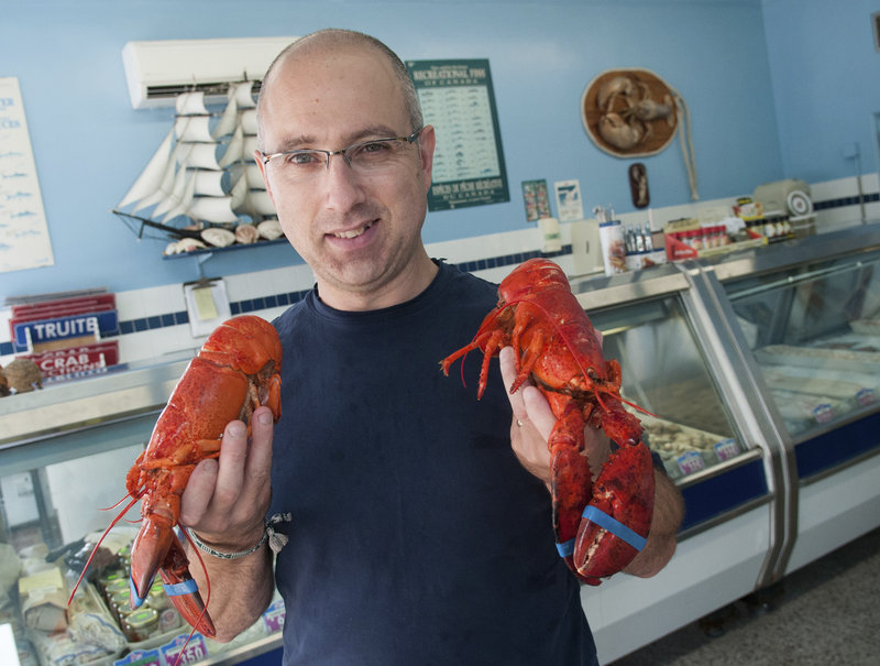 "Maurice Guimond manages the Moncton Fish Market in Moncton, New Brunswick. ""Think about going into work one day and having your boss tell you that you're going to make $2 less an hour. That's what has happened to these lobstermen,"" he said."