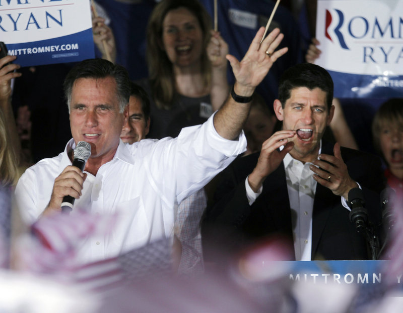 Republican presidential candidate former Massachusetts Gov. Mitt Romney, left, appears on stage with his newly announced vice-presidential running mate, U.S. Rep. Paul Ryan, R-Wis., during a campaign rally in Manassas, Va., on Saturday.