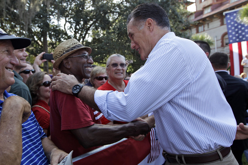 Mitt Romney greets Thomas and Patricia Evans during an event Monday at Flagler College in St. Augustine, Fla.