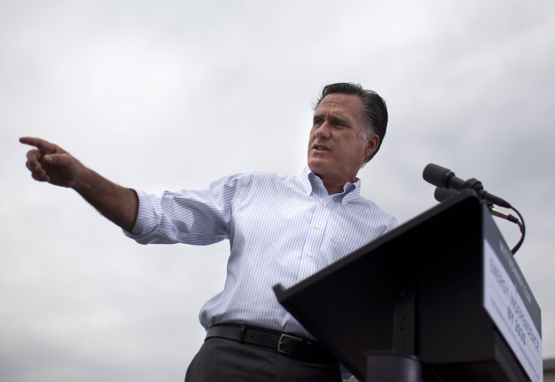 Former Massachusetts Gov. Mitt Romney speaks at a campaign rally Thursday in Hobbs, N.M. A bill he signed into law in 2006 sought to expand health care but did not guarantee coverage.