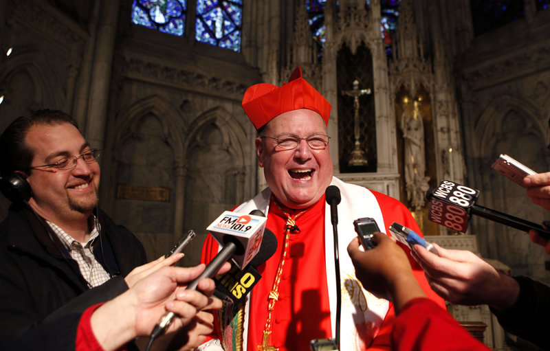 New York Cardinal Timothy Dolan speaks to the media after leading a morning prayer service at St. Patrick's Cathedral in New York City earlier this year.