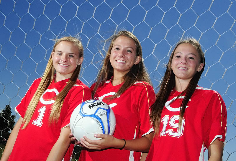 TRIPLETS: Lindsey Quirion, left, Hayley Quirion and Emily Quirion are playing for the Cony Rams soccer team this season.