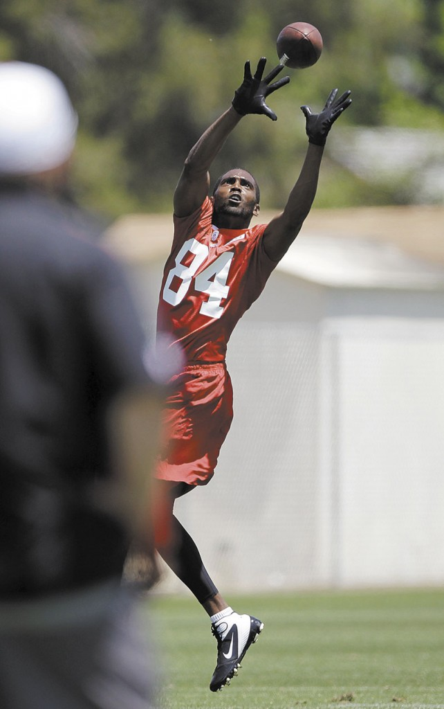 UP FOR GRABS: Randy Moss has looked good in training camp with the San Francisco 49ers despite taking last season off. The 35-year-old receiver is trying to make a comeback in the NFC West.