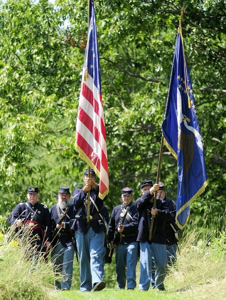 A group portraying soldiers from the 20th Maine walking into a clearing during a Civil War reenactment event on Saturday afternoon at Viles Arboretum in Augusta.