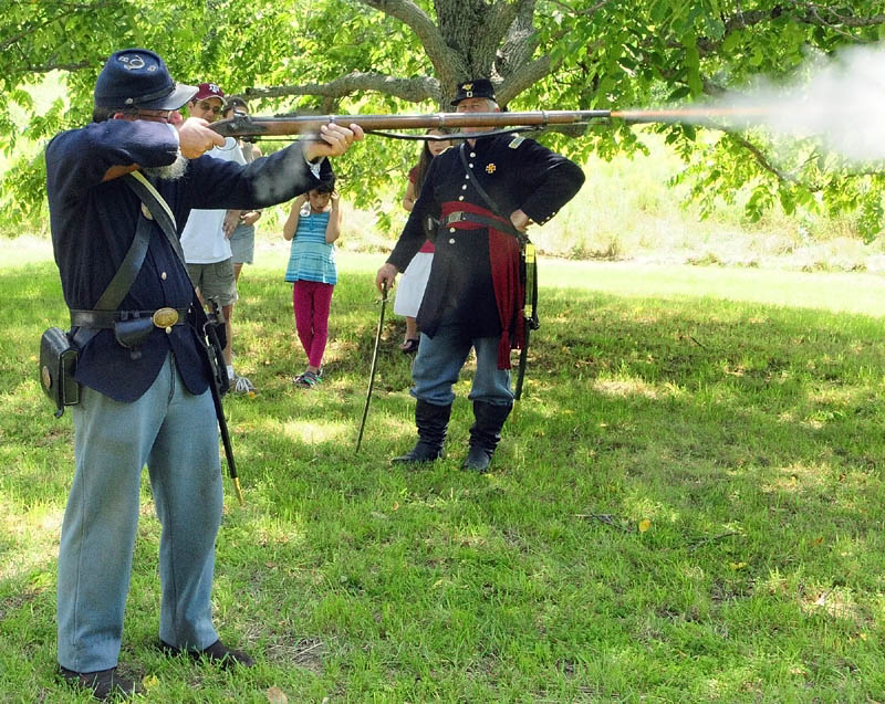 Art Custer, of Belfast, fires his weapon during a Civil War reenactment event on Saturday afternoon at Viles Arboretum in Augusta.