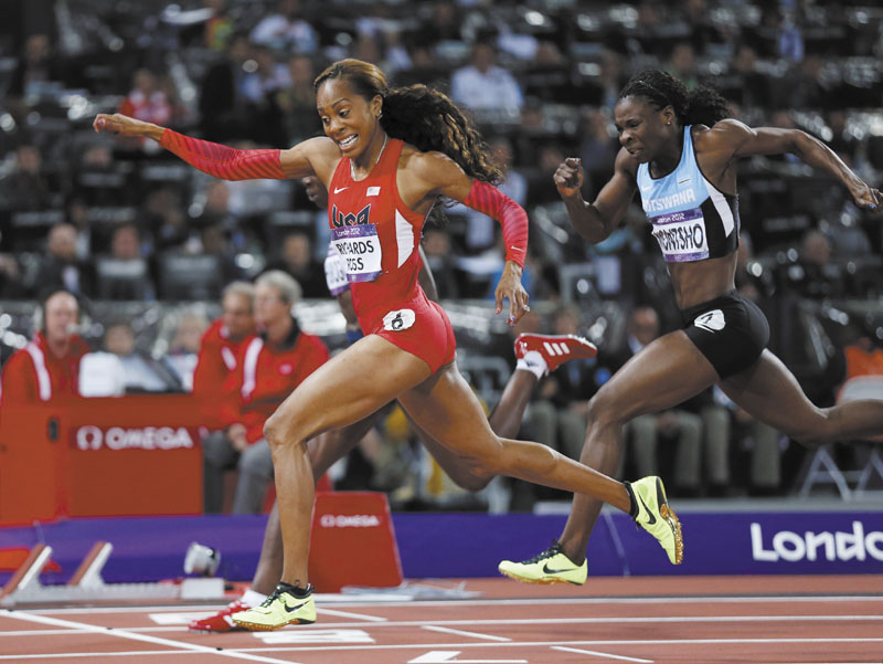 GOLDEN MOMENT: United States' Sanya Richards-Ross, left, crosses the finish line to win gold ahead of Botswana's Amantle Montsho, right, in the women's 400-meter final Sunday in London. 2012 London Olympic Games Summe