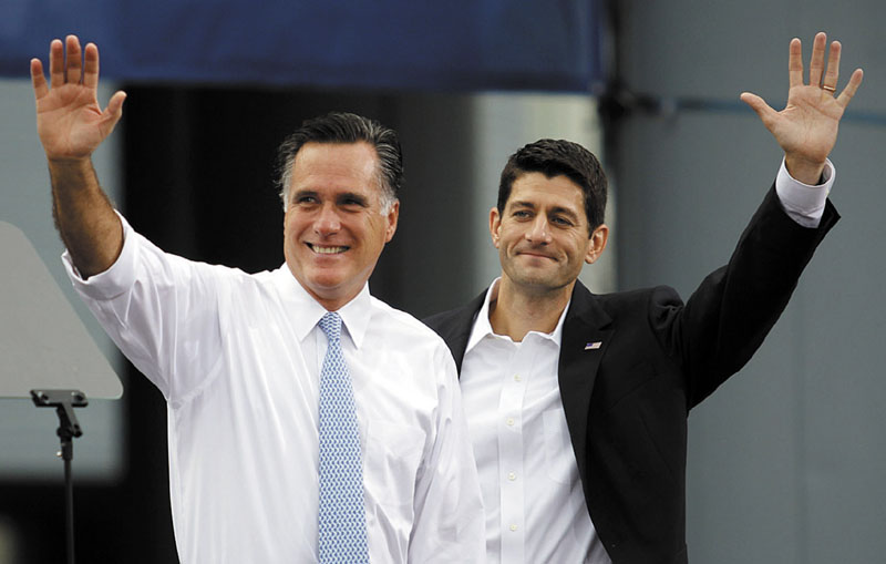 2012 ELECTION: Republican presidential candidate Mitt Romney, left, introduces his vice presidential running mate, Wisconsin Rep. Paul Ryan, on Saturday in Norfolk, Va. Romney