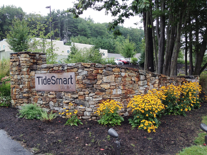 This is one of two stone-wall signs that flank the entrance to TideSmart Global, owned by Steve Woods, who is chairman of the Yarmouth Town Council and an independent candidate for U.S. Senate. Falmouth councilors agreed Monday night to seek a consent agreement and fine Woods because the stone-wall signs violate zoning regulations.