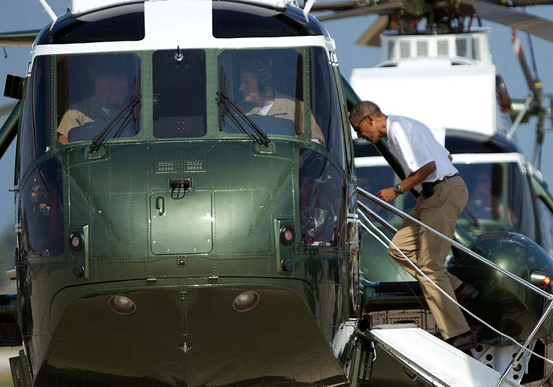 President Barack Obama boards Marine One helicopter as he departs Andrews Air Force Base, Md., for Camp David, Saturday. President Obama celebrated his 51st birthday Saturday with a round of golf and plans for a quiet weekend at Camp David, taking a break from campaigning three months before Election Day.