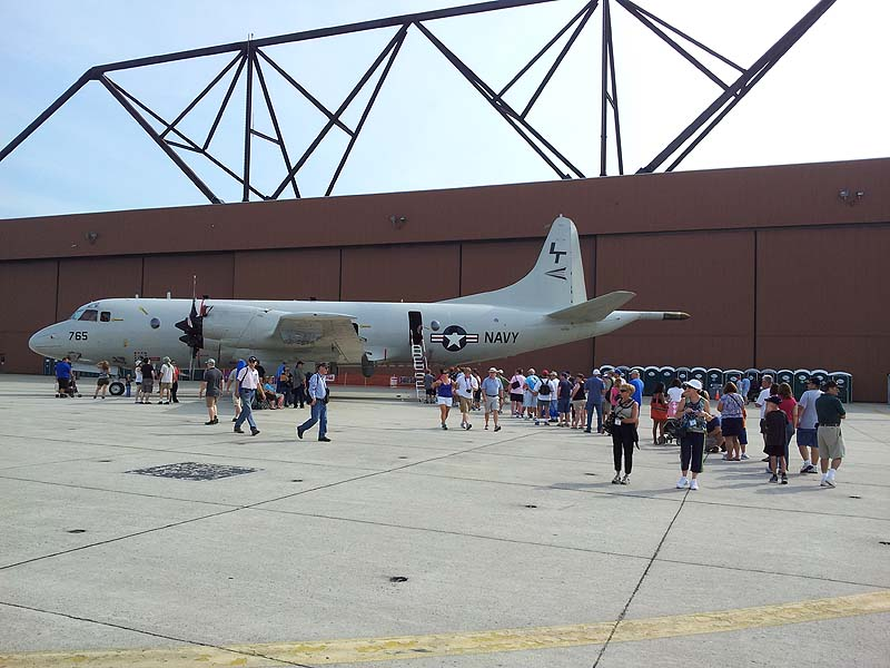 Air show visitors line up Saturday to tour a 28-year-old Navy P3 anti-submarine warfare aircraft, a version of the planes that were flown out of the former Brunswick Naval Air Station.
