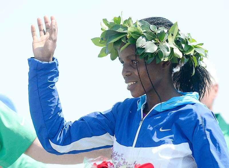 Margaret Wangari-Muriuki of Kenya is recognized at the awards ceremony after being the first woman to finish in Saturday's 2012 TD Beach to Beacon 10k in Cape Elizabeth.