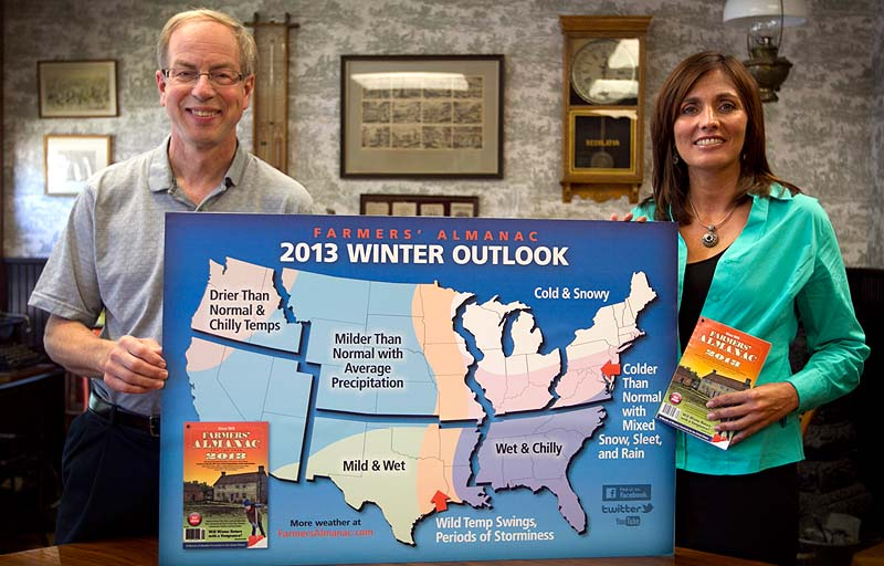 "Farmers' Almanac publisher Peter Geiger, left, and editor Sondra Duncan pose in Lewiston last week with a map showing the predicted weather forecast for the United States. In an election year, the almanac dubs its forecast ""a nation divided"" because there's a dividing line where winter returns for much of the east, with milder weather west of the Great Lakes."