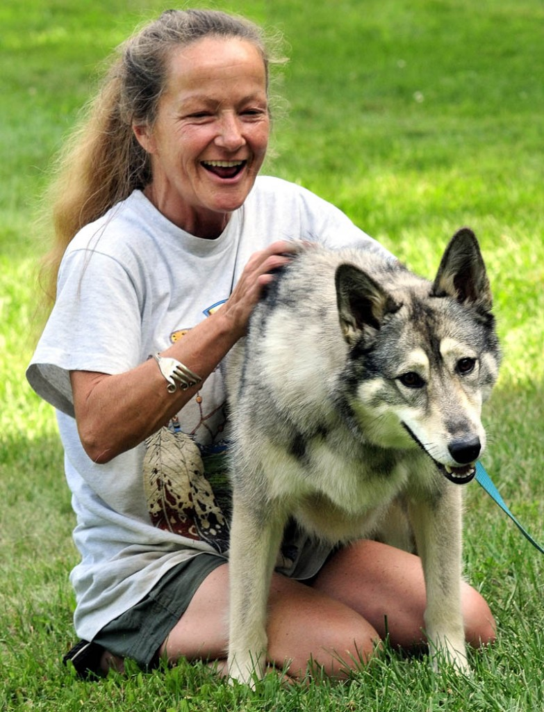 A WOLF HYBRID NAMED WOLF: Julie Mitchell and her husband Gene of Detroit are raising a two-year-old wolf hybrid named Wolf.