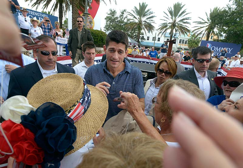 Republican vice-presidential candidate, Rep. Paul Ryan, R-Wis., center, greets the crowd after speaking at a campaign rally in The Villages, Fla., on Saturday.
