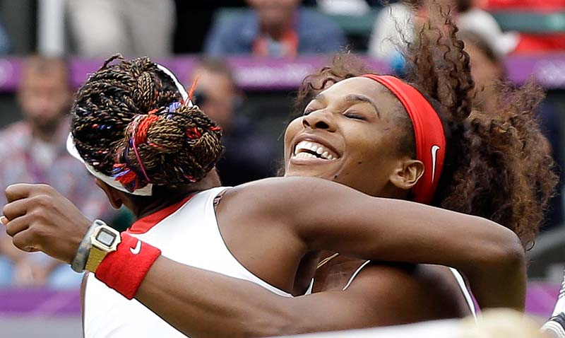 Serena Williams, right, and Venus Williams of the United States celebrate their victory against Andrea Hlavackova and Lucie Hradecka of the Czech Republic in the gold medal women's doubles match Sunday in London. 2012 London Olympic Games Summer Olympic games Olympic games Spo