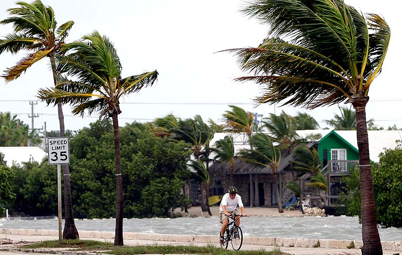 A cyclist rides his bike in Key West, Fla., on Sunday. Tropical Storm Isaac gained fresh muscle Sunday as it bore down on the Florida Keys, with forecasters warning it could grow into a dangerous Category 2 hurricane as it nears the northern Gulf Coast.