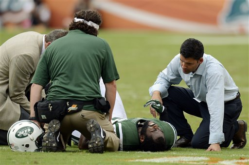 FILE - In this Sunday, Sept. 23, 2012 file photo, New York Jets trainers attend to cornerback Darrelle Revis (24) during the second half of an NFL football game against the Miami Dolphins, in Miami. Revis has a torn anterior cruciate ligament in his left knee that will require surgery, likely meaning he'll miss the rest of the season, the team announced Monday, Sept. 24. (AP Photo/Rhona Wise, File) Darrelle Revis