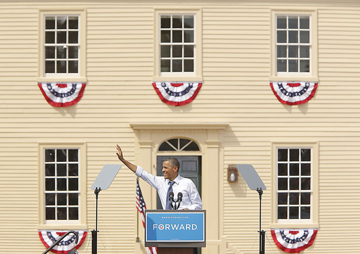 President Barack Obama waves to the crowd at the end of his speech in Portsmouth, N.H., on Friday.
