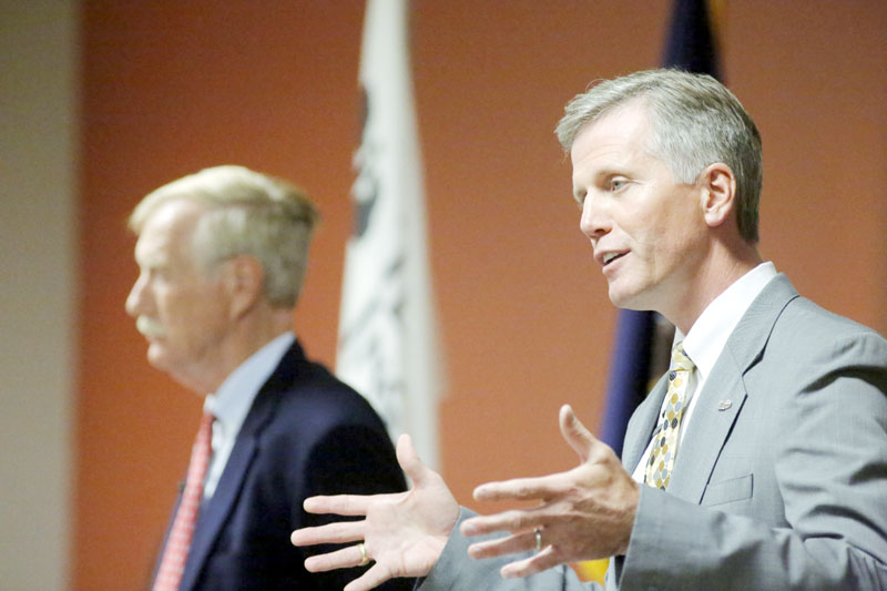 Republican candidate for U.S. Senate Charlie Summers answers a question during a debate at Texas Instruments in South Portland on Wednesday. At left is Independent candidate Angus King. Democratic candidate Cynthia Dill could not attend the debate because of a scheduling conflict.