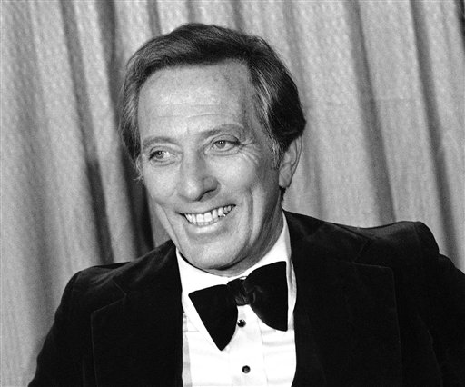 """FILE - This Feb. 23, 1978 file photo shows performer and host Andy Williams at the Grammy Awards in Los Angeles. Williams, who had a string of gold albums and hosted several variety shows and specials like """"The Andy Williams Show,"""" died Tuesday, Sept. 25, 2012, at his home in Branson, Missouri, following a yearlong battle with bladder cancer, his Los Angeles-based publicist, Paul Shefrin, said Wednesday. He was 84. (AP Photo/Lennox McLendon, file)"""