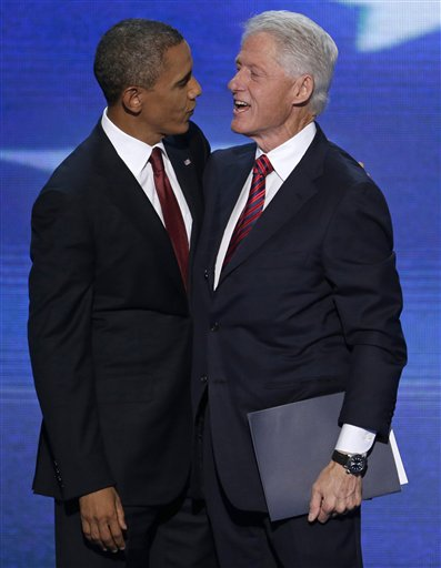Former President Bill Clinton talks with President Barack Obama after Clinton's speech to the Democratic National Convention in Charlotte, N.C., on Wednesday, Sept. 5, 2012. (AP Photo/J. Scott Applewhite)