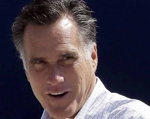 FILE - In this Sept. 23, 2012 file photo, Republican presidential candidate, former Massachusetts Gov. Mitt Romney gets ready to board his campaign plane in Los Angeles. Both presidential campaigns are trying to take advantage of an unusual Iowa law that gives their supporters a major say in determining where ballots can be cast before the election. Iowa�s law allows anyone who gets the signatures of 100 county voters to choose a specific voting place in that county. Before early voting begins Thursday, volunteers for both campaigns turned in a batch of petitions last week calling for voting at locations most convenient to their voters. (AP Photo/Charles Dharapak, File)