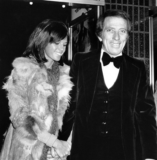 """FILE - In a Dec. 19, 1974 file photo, American singer Andy Williams and his wife Claudine Longet, shown upon arrival at the Odeon, Leicester Square, London, for the Royal Charity World premiere of """"The Man With the Golden Gun."""" Emmy-winning TV host and """"Moon River"""" crooner Williams died Tuesday night, Sept, 25, 2012 at his home in Branson, Mo., following a year-long battle with bladder cancer. He was 84. (AP Photo/Press Association, File)"""