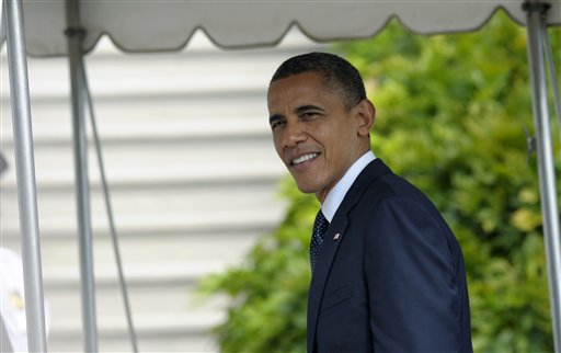 President Barack Obama answers a question as he returns to the the White House in Washington, Tuesday, Sept. 25, 2012. (AP Photo/Susan Walsh)