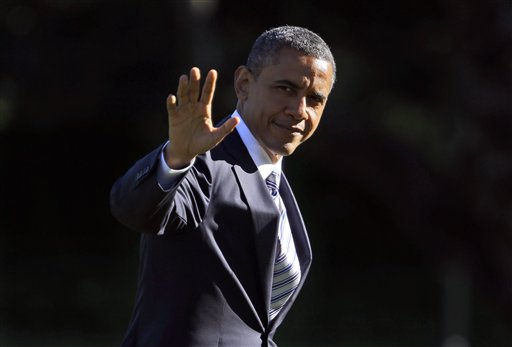 President Barack Obama waves as he walks across the South Lawn of the White House in Washington, during his return on Marine One helicopter, Tuesday, Sept. 11, 2012. Obama traveled to Walter Reed National Military Medical Center and visited with veterans who are being treated at the hospital and their families. (AP Photo/Pablo Martinez Monsivais)