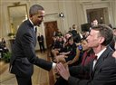 FILE - In this Feb. 7, 2012, file photo, President Barack Obama shakes hands with Bill Nye during an event in the East Room of the White House in Washington. Nye, a mechanical engineer and star of the popular 1990s Television show �Bill Nye The Science Guy,� recently waded into the evolution debate with an online video urging parents not to pass their religious-based doubts about evolution on to their children. (AP Photo/Susan Walsh, File)