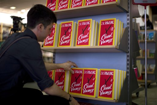 An employee adjusts copies of