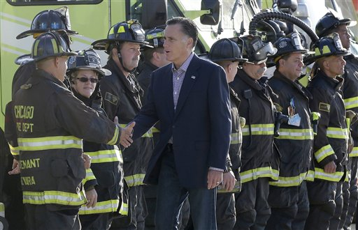 Republican presidential candidate Mitt Romney greets firefighters at Chicago O'Hare International Airport, Tuesday, Sept. 11, 2012. (AP Photo/Charles Dharapak)