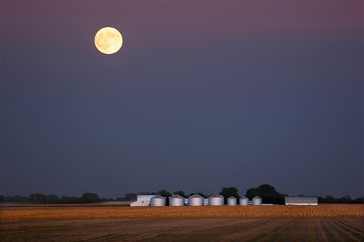 The moon rises over a freshly harvested corn field on a farm in Pleasant Plains, Ill. With the current farm bill scheduled to expire Sept. 30, competing versions of a new farm bill – which encompasses everything from crop subsidies to disaster relief and food stamps – have passed the full Senate and the House Agriculture Committee. But House Republican leaders have yet to allow a floor vote.