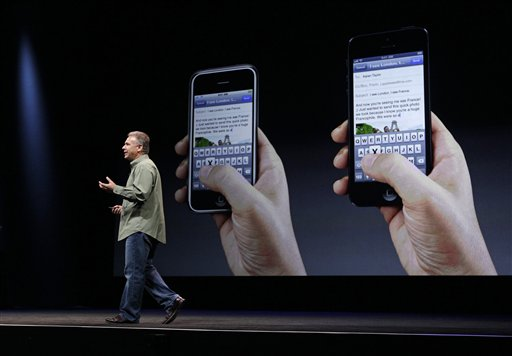 Phil Schiller, Apple's senior vice president of worldwide marketing, speaks on stage during an introduction of the new iPhone 5 at an Apple event in San Francisco on Wednesday.
