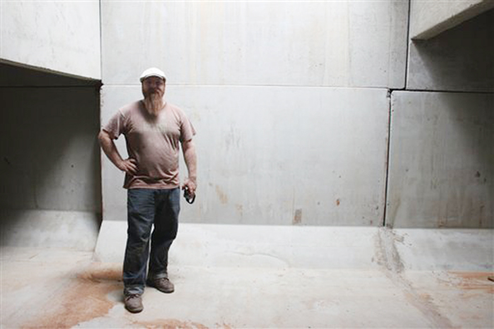 Cory Holliday, of the Tennessee chapter of The Nature Conservancy, stands in the newly completed artificial bat cave in Woodlawn, Tenn. on Tuesday.