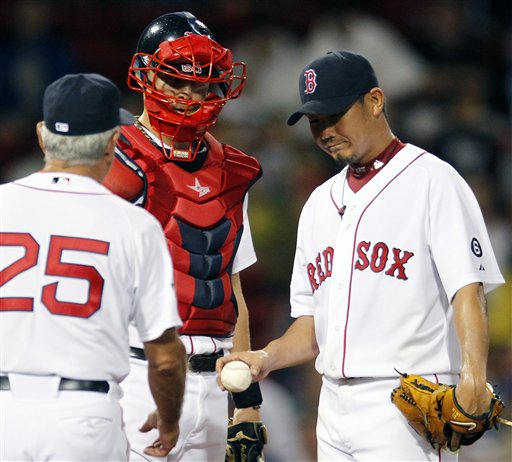 Boston Red Sox's Daisuke Matsuzaka, right, hands the ball to manager Bobby Valentine (25) as Ryan Lavarnway, left, looks on in the second inning of a baseball game against the Toronto Blue Jays in Boston, Saturday, Sept. 8, 2012. (AP Photo/Michael Dwyer)