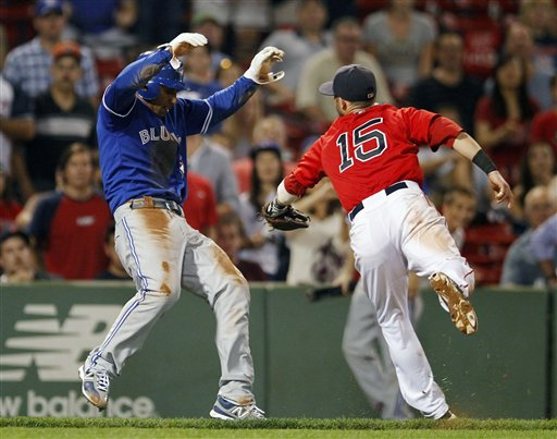 Boston Red Sox's Dustin Pedroia (15) tags out Toronto Blue Jays' Anthony Gose left, in a run down in the ninth inning of a baseball game in Boston, Friday, Sept. 7, 2012. (AP Photo/Michael Dwyer)