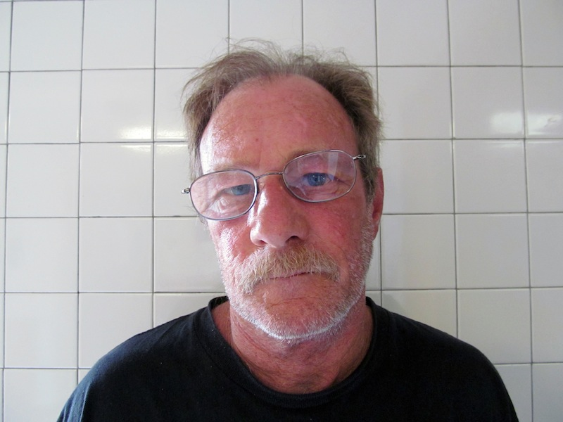 """In this photo provided by the Roland, Oklahoma Police Department, Michael Eugene Brewster is pictured in a booking photo dated Sept. 13, 2012. Brewster, a suspected cross-country bank robber who told one teller that he had cancer and """"did not care what happens"""" was arrested in eastern Oklahoma after a traffic stop more than 1,000 miles away from his most recent heist, the FBI said Friday. (AP Photo/Roland, Oklahoma Police Department)"""