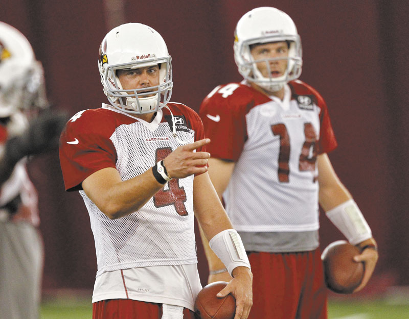 WHO WILL IT BE?: Arizona Cardinals quarterbacks Kevin Kolb (4) and Ryan Lindley run drills during practice Thursday at Arizona State University in Tempe, Ariz. The Cardinals have not announced who will start at quarterback against the New England Patriots on Sunday.