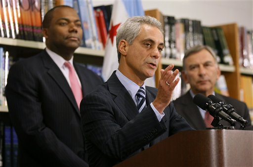 Chicago Mayor Rahm Emanuel, center, is flanked by Chicago Public Schools CEO Jean-Claud Brizard, left, and school board president David Vitale during a news conference after the teachers union House of Delegates voted to suspend their strike Tuesday in Chicago.