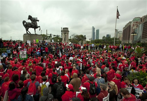 A crowd of public school teachers rally at Chicago's Congress Plaza on Thursday to protest against billionaire Hyatt Hotel mogul Penny Pritzker, who is also a member of the Chicago Board of Education. Protesters said that $5.2 million in Tax Increment Financing (TIF) funds being used to build a new Hyatt hotel in Hyde Park would be better spent on meeting basic student needs.