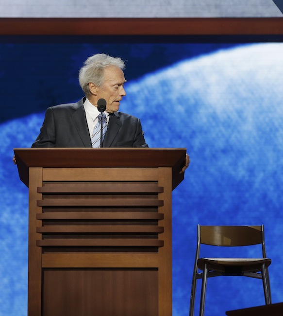 This Aug. 30, 2012 file photo shows actor Clint Eastwood addressing an empty chair at the Republican National Convention in Tampa, Fla. More than a week after Clint Eastwood delivered a speech to the Republican National Convention, the veteran Hollywood actor-director continues to be mocked for his peculiar, rambling conversation with an imaginary President Barack Obama in an empty chair on stage, begging the question: Will his latest film also be playing to empty seats when it debuts later this month? (AP Photo/Charles Dharapak, file)