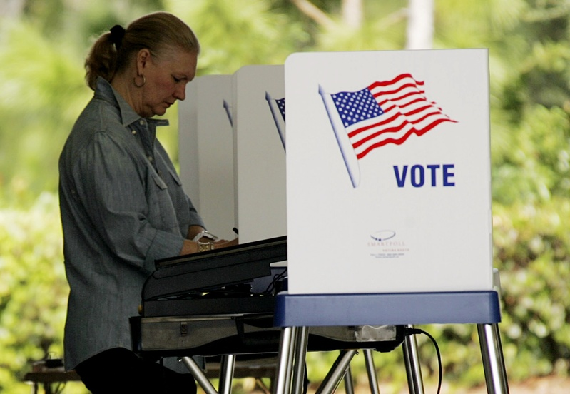 A woman votes at a fire station in Jupiter, Fla., on Nov. 4, 2008. The Republican Party of Florida has fired a get-out-the-vote firm after learning of questionable new voter registrations submitted in at least 10 Florida counties.