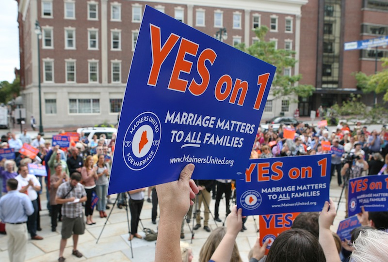 Gay marriage supporters gather Monday Sept. 10, 2012 at a rally outside of City Hall in Portland, Maine, in support of an upcoming ballot question that seeks to legalize same-sex marriage. (AP Photo/Joel Page)