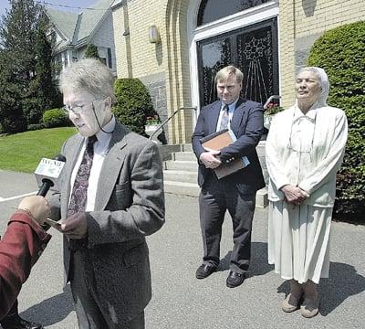 Jamie Morrill, then-assistant commissioner of the Department of Behavior and Development Services, speaks to the media outside the Blessed Sacrament Chapel in Waterville in this 2003 file photo regarding the decision to allow Mark Bechard supervised leaves from AMHI. At right iattorney David Bernier and Sister Mary Catherine Perko. morrill jamie morris john perko mary bernier david blessed sacrament bechard