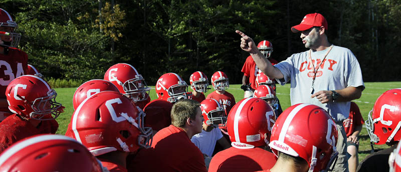 Staff photo by Andy Molloy TALKING ABOUT WINNING: Cony Football coach Rob Vachon speaks with his team Tuesday during practice in Augusta. The Rams are 3-1 in and in the midst of their first three-game winning streak since 2007.