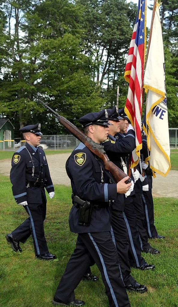 AN HONOR: Gardiner police officers rehearse a color guard presentation of flags Thursday in Gardiner. The police are carrying the colors tonight at Fenway Park in Boston.